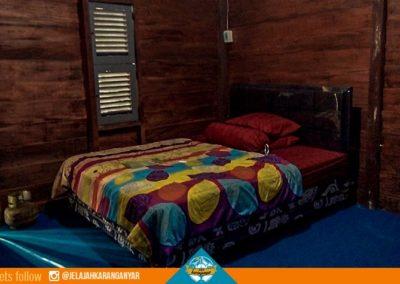 Tempat tidur di pondok wisata